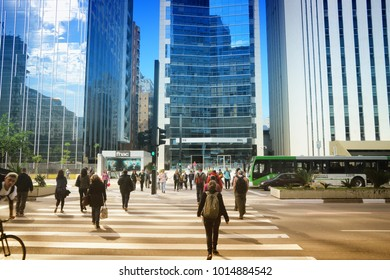 SAO PAULO, BRAZIL - OCTOBER 6, 2014: People visit Avenida Paulista avenue, Sao Paulo. With 21.2 million people Sao Paulo metropolitan area is the 8th most populous in the world.