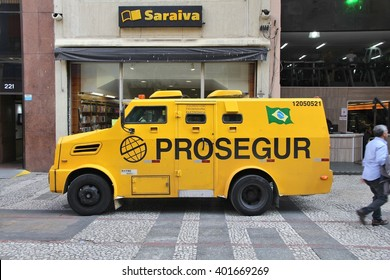 SAO PAULO, BRAZIL - OCTOBER 6, 2014: People pick up money from store in armored vehicle in Sao Paulo, Brazil. Robberies and other violent crimes are frequent in Brazil.