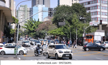 SAO PAULO, BRAZIL - OCTOBER 6, 2014: People drive in Sao Paulo. With 21.2 million people Sao Paulo metropolitan area is the 8th most populous in the world.
