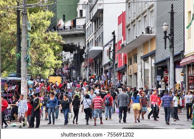 SAO PAULO, BRAZIL - OCTOBER 6, 2014: People shop at Rua General Carneiro in Sao Paulo. With 21.2 million people Sao Paulo metropolitan area is the 8th most populous in the world.