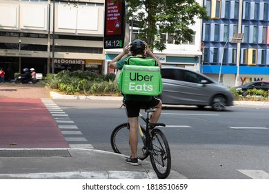Sao Paulo, Brazil - sept 19 2020: worker Uber Eats on the bike delivers food to customers.