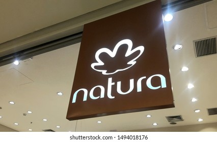 Sao Paulo / Brazil - September 01 2019: Closeup of the lettering and logo of Natura beauty shop on its facade.