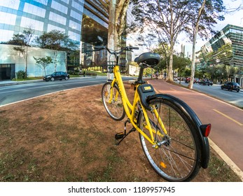 Sao Paulo, Brazil, September 19, 2018. Yellow OFO bicycle in the Brigadeiro Faria Lima Avenue. From Chinese bike sharing company parked in Sao Paulo ready for hire by user of smartphone app.