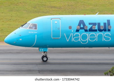 Sao Paulo / Brazil - September 21 2019: Close view of Azul Airlines Embraer ERJ 195 nose light blue special livery to Azul Viagens, the travel agency of the Brazilian airline. ERJ195 PR-AYY.