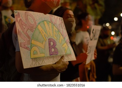 Sao Paulo / Brazil - September 25 2020: Participants protesting in a demonstration for climate change (Ato Global pelo Clima) in front of IBAMA with banners against fires in Pantanal and Bolsonaro.