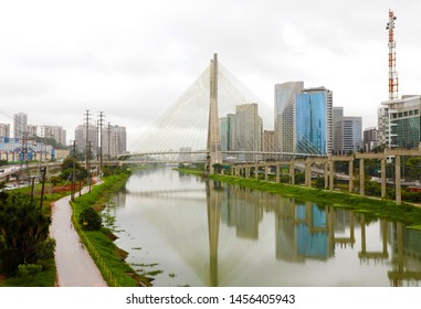 Sao Paulo city landmark Estaiada Bridge reflex in Pinheiros river, Sao Paulo, Brazil