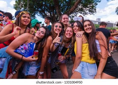 "Sao Paulo, SP / Brazil - 03/05/2019: Revelers of ""Bloco da Latinha Mix"" posing for photos on the Sao Paulo's street carnival at the region of Ibirapuera Park."