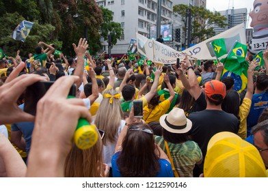 Sao Paulo, SP, Brazil, 2018/10/21, Demonstration pro presidential candidate Jair Bolsonaro on Paulista Avenue - thousands gather around sound truck to watch a live stream by the candidate