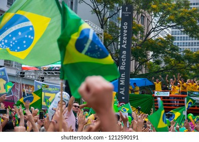 Sao Paulo, SP, Brazil, 2018/10/21, Demonstration pro presidential candidate Jair Bolsonaro on Paulista Avenue - demonstrators express their support raising their clinched fists into the air