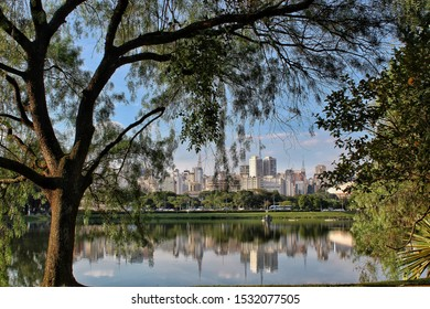 Sao Paulo SP, Brazil - April 30, 2019: Ibirapuera park at Sao Paulo SP Brazil. Lake of the park and the buildings of the city on background. Panoramic view of Parque Ibirapuera.