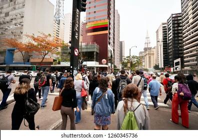 Sao Paulo, SP, Brazil, Dez, 2018: Crowded Street Avenue Warm Beautiful Scene of Productive People in Capital