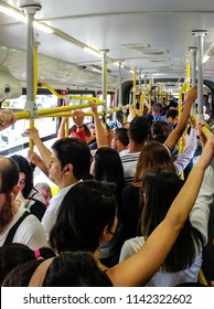 Sao Paulo, SP / Brazil - February 27, 2018: Crowded bus on rush hour in Sao Paulo, Brazil. Public transport, one of the historical issues in Sao Paulo's metropolis. July 9 Avenue, 6913 line.