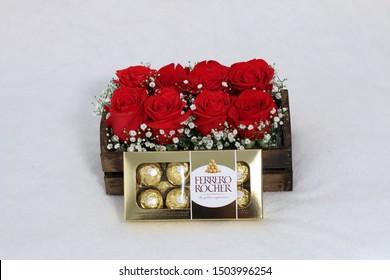Sao Paulo, SP / Brazil - February 28, 2017. Flower arrangement with chocolate Ferrero Rocher. Ferrero Rocher  is a chocolate produced by the Italian chocolatier Ferrero SpA .