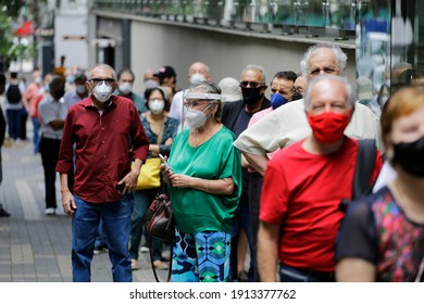 Sao Paulo, SP, Brazil - February 9, 2021: People wait in a big line to vaccinate against COVID-19 during a priority vaccination program for elderly people.