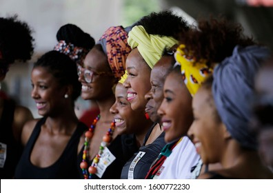 Sao Paulo, SP / Brazil - July 25, 2017: Group of women smile as they pose for a photo during a march to mark the International Afro Latin American and Afro Caribbean Women's Day.