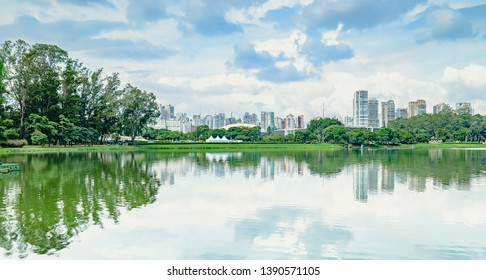 Sao Paulo SP, Brazil - March 02, 2019: Ibirapuera park at Sao Paulo SP Brazil. Lake of the park and the buildings of the city on background. Panoramic view of Parque Ibirapuera.