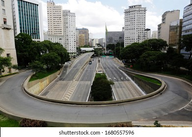 Sao Paulo, SP / Brazil - March 22, 2020: Empty street and avenue are seen in downtown SP due to coronavirus outbreak, COVID-19.