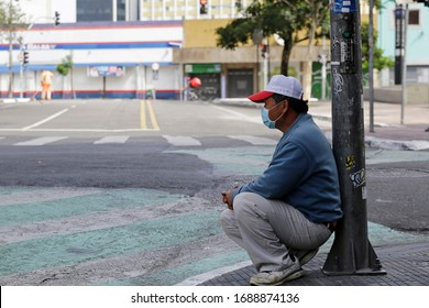 Sao Paulo, SP / Brazil - March 29, 2020: A asian man looks on a empty street in the famous touristic Liberdade neighborhood, downtown, due to Coronavirus outbreak, COVID-19.