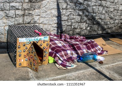 Sao Paulo, SP, Brazil, May 24, 2018. Belongings of a homeless person and a dog house made of cardboard in a corner in the south zone of Sao Paulo