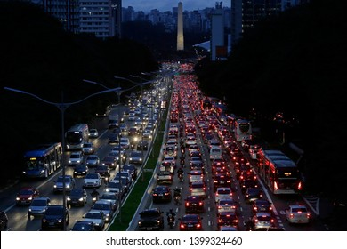 Sao Paulo, SP / Brazil - May 13, 2016: Heavy traffic jam is seen in 23 de maio avenue, near Obelisk, during rush hour.
