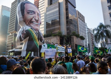 SAO PAULO, SP, BRAZIL - MAY 26, 2019: Pro-government political demonstration on Avenida Paulista, with banners and posters and the beautiful architecture in the background.