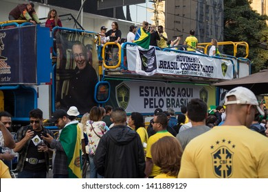 SAO PAULO, SP, BRAZIL - MAY 26, 2019: Pro-government political demonstration on Avenida Paulista, with banners and posters and a sound truck serving as a platform.