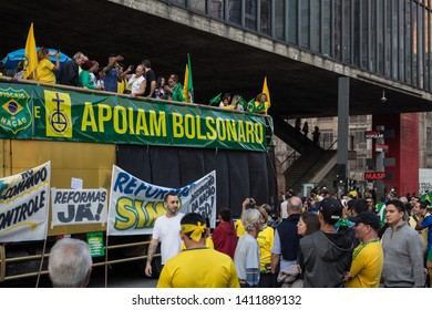 SAO PAULO, SP, BRAZIL - MAY 26, 2019: Pro-government political demonstration on Avenida Paulista, with posters and banners, under the MASP -São Paulo Art Museum, traditional local protest of the city.