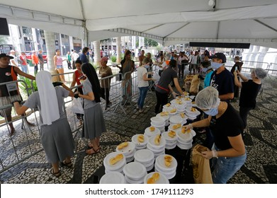 Sao Paulo, SP / Brazil - May 2, 2020: People form a big line to receive food donations for lunch in downtown amid a severe economic crisis caused by Coronavirus, COVID-19 pandemic.