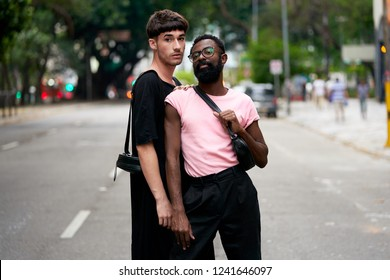 Sao Paulo, SP, Brazil, Nov, 2018:  Real Multiethnic Gay Couple, Afro American and White Man Embrance, Hands Together in Love. Authentic Street Style Fashion Shoot and Rights Celebration