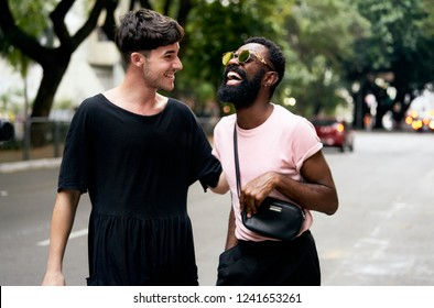 Sao Paulo, SP, Brazil, Nov, 2018:  Real Multiethnic Gay Couple, Afro American and White Man Embrance Laughing, Giant Smile in Love. Authentic Street Style Fashion Shoot and Rights Celebration