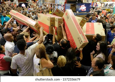 Sao Paulo, SP / Brazil - November 22, 2018: Shoppers rush to buy televisions during a Black Friday sale at a Extra department store.