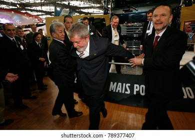 Sao Paulo, SP, Brazil - oct07, 2009 - Luiz Inacio Lula da Silva is a current candidate for presidential elections, skips a grid  during a visit to transport fair (sequence 06)