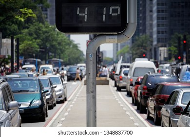 Sao Paulo, SP / Brazil - October 31, 2012: Street digital thermometer display a temperature of 41degrees celsius at Paulista avenue, avenida paulista, during a extreme heat wave.