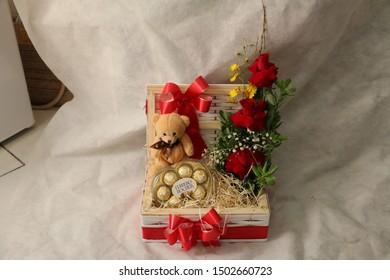 Sao Paulo, SP / Brazil - October 30, 2015. Chocolate Ferrero Rocher with flower arrangement in the basket. Ferrero Rocher is a chocolate produced by the Italian chocolatier Ferrero SpA .