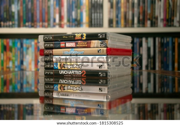 SAO PAULO, SP, BRAZIL - SEPT 2nd, 2020: Pile of PS3 Blue ray Box Games. Some Of The Playstation Vita Games Stack together and placed closely. Selective focus.