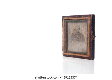 SAO PAULO, SP/BRAZIL, JULY 20, 2016: Old and vintage Daguerreotype case with a portrait on it over a white background with reflection. Illustrative editorial image.
