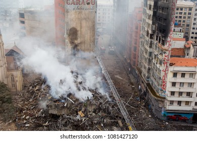 Sao Paulo/Brazil May 01 2018 Firefighters work in the aftermath and search for possible victims of the fire that struck two buildings. One building already housed an office of the Federal Police.
