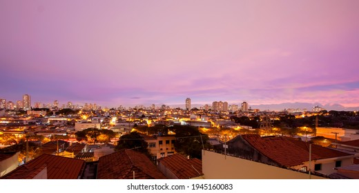 Sao Paulo's east zone cityline just after sunset. Purple sky in long exposure above the city.