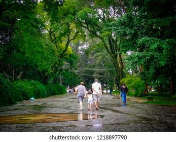 Sao Paulo/SP/Brazil - 01-25-2010: Family walks in Ibirapuera Park in rainy afternoon