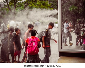 Sao Paulo/SP/Brazil - 01-25-2010: Young people taking fresh air after hiking in Ibirapuera Park