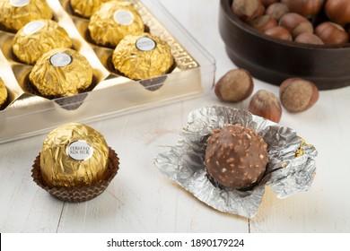 Sao Paulo-SP-Brazil - 08-01-2021: Ferrero Rocher chocolates and hazelnuts over wooden table.