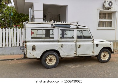 Sao Tome, West Africa - 3rd August 2017: Well used Ambulance Landrover Defender parked on a side street beside a Clinic.