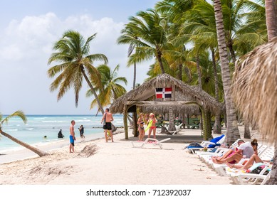 SAONA, DOMINICAN REPUBLIC - MAY 25, 2017: People relax on the sandy beach. Copy space for text