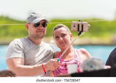 SAONA, DOMINICAN REPUBLIC - MAY 25, 2017: The couple takes pictures of themselves on the deck of the yacht. Close-up