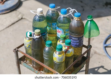 SAPA, VIETNAM - 22ND MARCH 2017: Various bottles containing gasoline outside a shop in Sapa Vietnam. This is a common way that fuel is presented to patrons in this region.