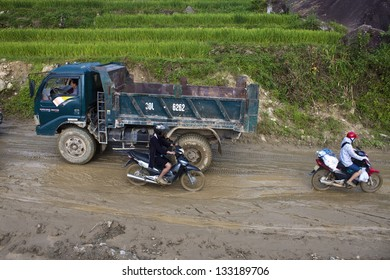 SAPA, VIETNAM - AUGUST 12: Traffic on a muddy road on August 12, 2012 near Sapa, Vietnam. This rural area is settled by members of ethnic minorities, especially Hmong.