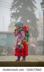 SAPA, VIETNAM - Feb 12, 2018:  Cute ladies go to sell handmade products. On a cold day  in Sapa on February 12, 2018 in Sapa, Vietnam.