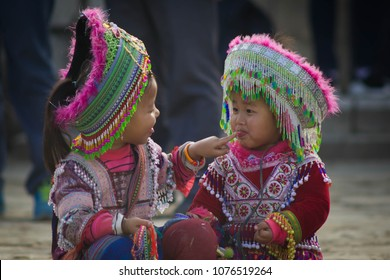 SAPA, VIETNAM - Jan 2 2018 : Unidentified cute girl of the H'mong indigenous women at walking street on Jan 1 2018 in Sapa,Vietnam.Flower H'mong tribes is one of the minority tribes in Sap