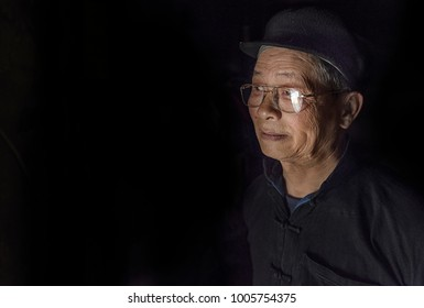 SAPA VIETNAM MARCH 2015: Portrait of old man inside his house in a small village in Sapa, Vietnam