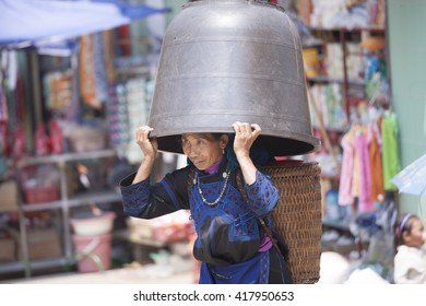 SAPA, VIETNAM, May 01,2016: Hmong woman people are colorful costume trading of agricultural products at the LAOCAI sunday market in Sapa Vietnam.